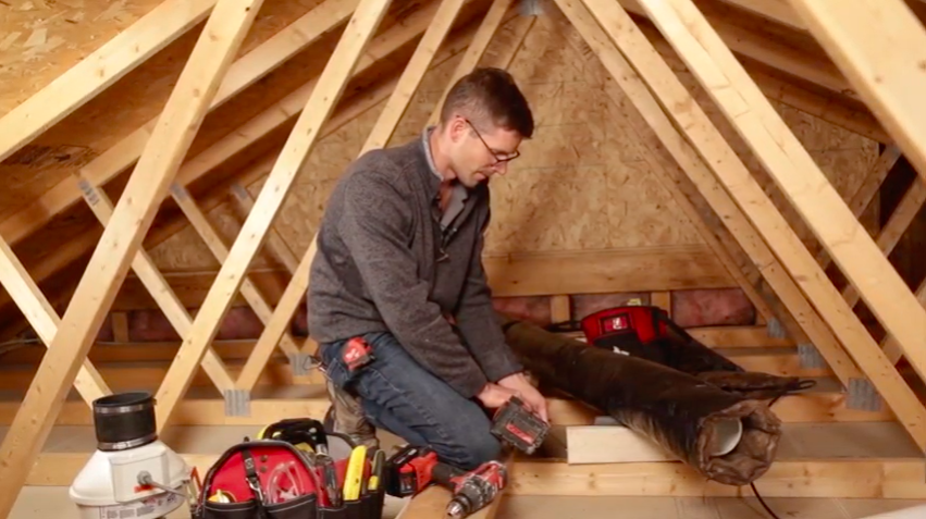 Garage attic radon vent pipe support